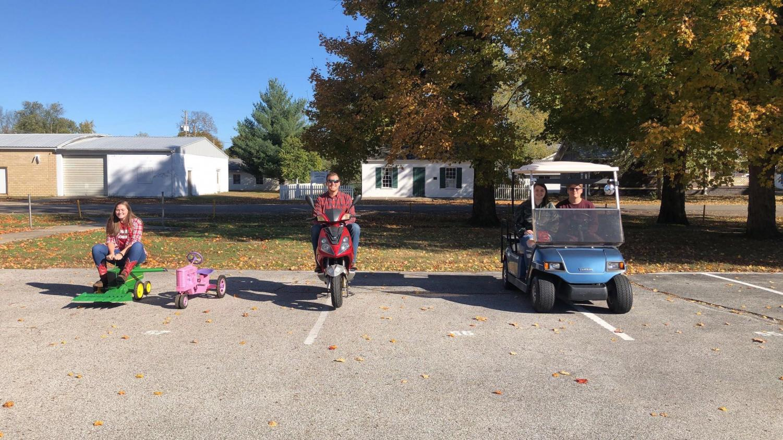 Krescene Holscher, Mr. Will, Layni Branson, and Nathan White in their alternative vehicles.