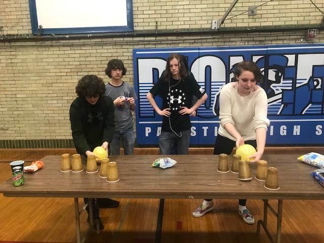A Very Intense Game! Caden McCormick and Stephanie Rudd participate in a game during the school fun day. Evan Easton, who is the judge, watches in disgust because he is a pro.