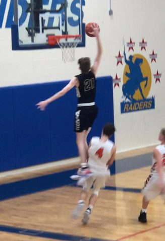 "PHS Junior Gavin Besing soars over an opposing player for a dunk during the 2019 Thanksgiving Turkey Tourney. Gavin Besing said, ""This year is looking good for us; we wanted to come out of the tournament 2-3 and we came out 3-2. I"