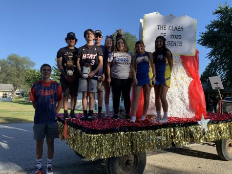 Juniors stand aboard their junior class float.  The float received first place in the Homecoming float competition.