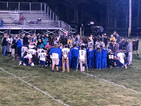 OPH and Dugger coming together at the end of the game for a prayer.