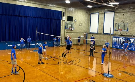 Junior Elliot Meadows is going up for the spike during HOCO volleyball.  The juniors beat the freshman during that game.