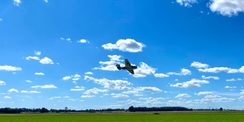 The Crawford County Airport presents: Wings By The Wabash.  Pictured is an airplane performing.