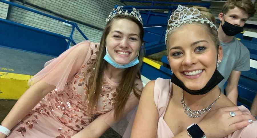 Krescene Holscher and Makinley Bonesteel are princesses for the day on HOCO Royalty day.  The two of them coincidentally matched in their pink gowns.