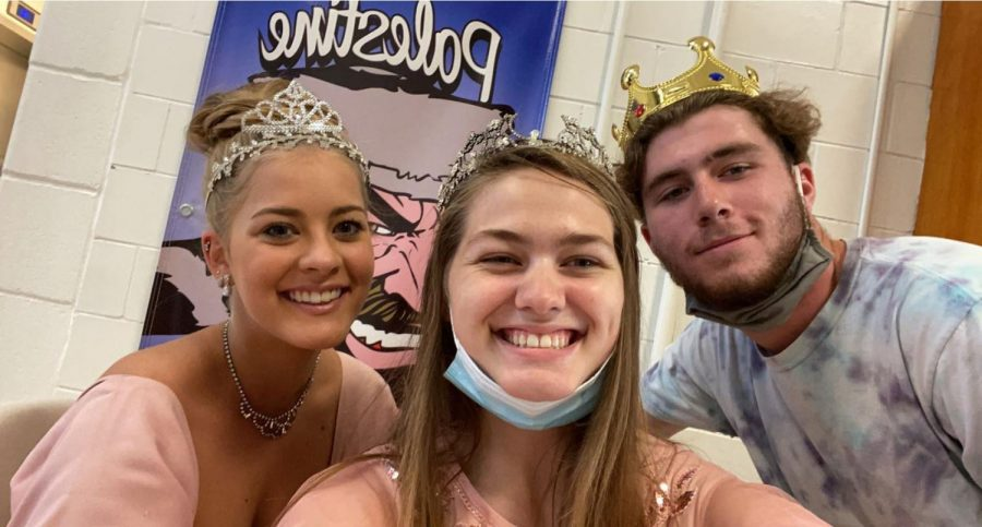 Makinley Bonesteel, Krescene Holscher, and Gavin Postlewaite pose during HOCO Royalty day.  Six of the seventeen members of the senior class dressed up for Royalty day Monday, September 13.