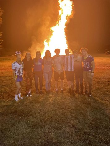 PHS seniors pose in front of the bonfire after the Homecoming Parade Wednesday night.  The Homecoming bonfire has been a PHS tradition for many years.
