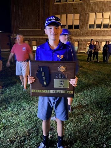 Cody York holds the Sectional Championship trophy.   The boys OPH golf team won Sectionals on Monday, October 4.